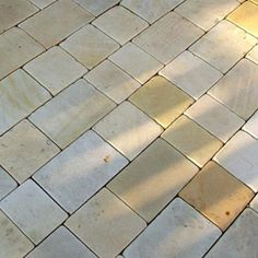 Sandstone cobbles/driveways setts - This sandstone is perfect for both driveways and paved areas where a border is required.