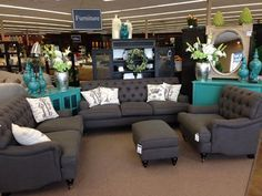 living room color scheme.  LOVE the dark gray and teal.