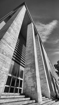 Tall, unadorned and raised columns create a strong look for the façade of the Collegio Aeronautico G. It was designed by Cesare Valle and completed in Atrium, Facade, Past, Skyscraper, Multi Story Building, Italy, Tours, Traditional, Rationalism
