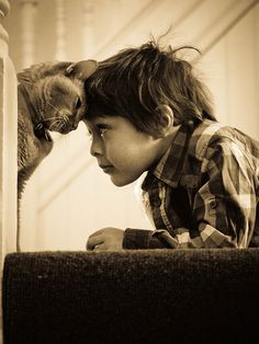 "The boy and the cat...   Well I'd rather say  ""A meeting of two minds."""