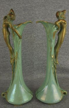 Amphora Pottery, Ernst Wahliss, Austrian, Art Nouveau ewer-shaped vases in the form of callas with nymph handles, early crown mark, 12.5 in. high