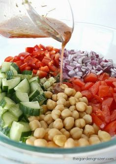 Ultimate Greek Chopped SaladIngredients  1 hothouse cucumber  4-5 ripe roma tomatoes  1 large red bell pepper  1 small red onion  15 oz. can garbanzo beans, rinsed and drained Optional: olives, feta, pepperoncini  {For the dressing}  3 Tbsp. red wine vinegar  1/4 cup olive oil  2 tsp. oregano  1/4 tsp. salt