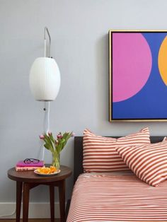 Great round shapes. Cool striped bedding. Love the girly pop colors.