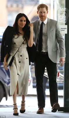 Meghan looked business-like in a pinstripe dress by Altuzarra, teamed with black strappy sandals and a blazer by Camilla and Marc