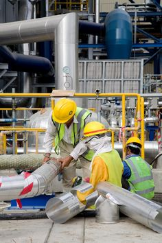 View of staff working on pipes on Fujairah GT26 Power Plant, UAE.