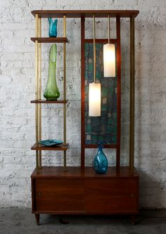 Outstanding room divider/shelf with pendants. Kinzco    Think of the possibilities, here. I do love this Mid-Century period.