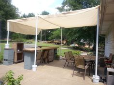 Made this canopy to cover the bar/seating area this weekend (July 2014). Nice shade! It will do until we can build a nice wooden structure over the entire patio.....lol, in about 20 years or so. The bar top we made in 2013 worked great, needs a little sanding and more sealer, but we love it!