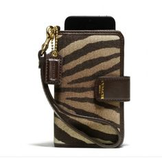Coach wristlet wallet Never been used. Has a place to hold a phone. In perfect condition Coach Bags Clutches & Wristlets