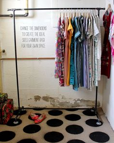 DIY garment rack. We have similar ones screwed into the wall in the store and LOVE them!
