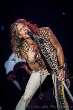 ...Steve Tyler...Don't bash this hottie of the day.  Always found him sexy.