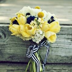 yellow and white flower arrangement for a navy color inspired wedding