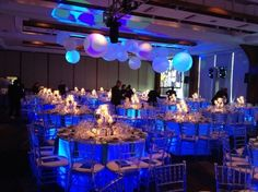 Blue #uplights underneath table linens create this amazing effect for a #wedding reception #RentMyWedding