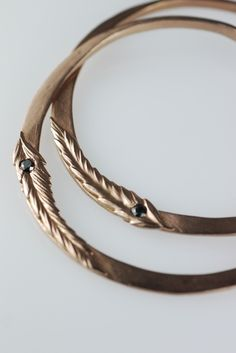 Rose Gold Feather Hoops Black DiamondsAll items are made to orderPlease allow up to 30 days for delivery.