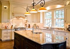double kitchen island contrasting granite | ... lights with a traditional touch above a glazed marble kitchen island