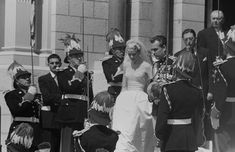 The 32 year old Prince Rainier III and his 26 year old bride (now Princess Grace) leaving the church following the Catholic wedding ceremony.