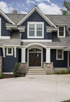 Color Navy exterior paint color with white trim. Navy exterior paint color is Benjamin Moore Hale Navy. Navy exterior white trim home ideas. Navy homes. Navy home Ideas. Navy home white trim paint color ideas. House Paint Exterior, Exterior House Colors, Exterior Design, Blue House Exteriors, Exterior Paint Ideas, Exterior Paint Colors For House With Stone, Craftsman Home Exterior, Rustic Exterior, Stucco Exterior