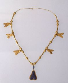 Necklace with Fly Pendant  Medium: Gold, lapis lazuli  Place Collected: Egypt  Dates: ca. 1539-1292 B.C.E.  Dynasty: XVIII Dynasty  Period: New Kingdom