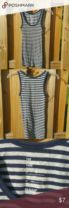 Navy and gray striped Gap Essential Tank Cute navy and gray striped essential tank from Gap. Size Small, 95% cotton, 5% spandex, machine wash cold. Tops Tank Tops