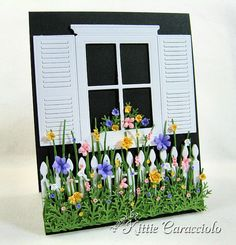 the flowers and greenery are pieced together on this card