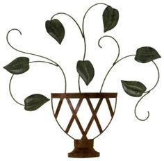 Fetco Home Décor Lillian Plant Wall Art by Fetco Home Décor. $39.88. 22x22 wall art. Lillian-plant. Wall-burnished red gold and new verdigris. Lillian-Wall Art-Plant-Burnished Red Gold and New Verdigris at 22x22 has a beautiful leaf pattern display in a vase motif that's perfect for the Wall.