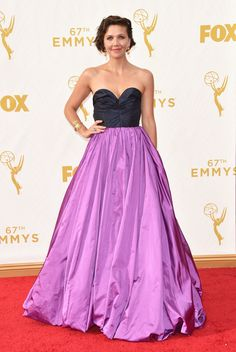 Maggie Gyllenhaal wears a strapless purple gown by Oscar de la Renta