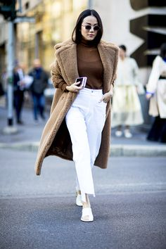 milan fashion week street style spring 2018 tan coat brown turtle neck white pants white shoes