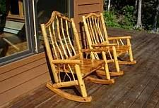 Rocking chairs made from spruce and branches.