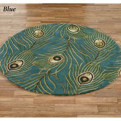 blue peacock feathers round rug from Touch of Class