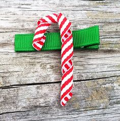 Free US Shipping for orders of $15 or more (excluding shipping).. Use coupon code freeshipping at checkout :) This adorable Candy Cane Ribbon Sculpture Hair Clip is the perfect accessory for girls of all ages! Looks so cute worn alone, or attached to an interchangeable headband. Perfect