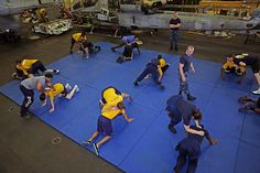 GULF OF ADEN (August 02, 2013) Sailors practice mechanical advantage combat hold (MACH) takedowns during a Security Reaction Force-basic (SRF-B) course aboard the amphibious assault ship USS Kearsarge (LHD 3). Kearsarge is the flagship for the Kearsarge Amphibious Ready Group and, with the embarked 26th Marine Expeditionary Unit, is deployed in support of maritime security operations and theater security cooperation efforts in the U.S. 5th Fleet AOR. (U.S. Navy photo by Travis…