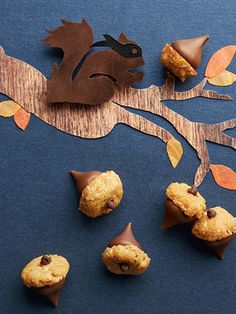 A small peanut butter cookie and a chocolate kiss in the form of an acorn make a tasty and festive fall dessert.