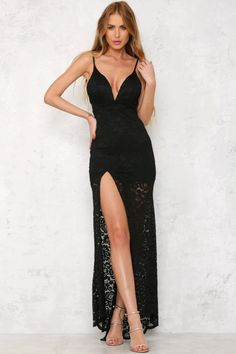 The stunning Met Gala Maxi Dress is a dramatic design with lace overlay topped with a plunging V-neck with padding in the bust and boning to hold its shape. There's a slit on the side and hidden zipper on the back as well as adjustable straps. Wear with contrasting stilettos and delicate gold jewellery for a classy, put-together look.  Maxi dress.  Partially lined. Cold hand wash only. Model is standard XS and is wearing XS. True to size. Stretchy fabric. Polyester.