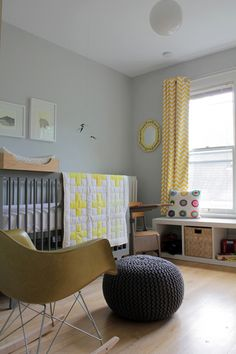 """Sneak Peek: Alison and Jeff Allen. """"We started decorating Gus' nursery before we knew if Gus was going to be a boy or girl. With that in mind, we decided to go with a gender-neutral yellow and gray color palette. The quilt, curtains and the pillow are all handmade by me, and I'm glad they make their home in Gus' room. We love our Oeuf Sparrow crib; it was an expensive investment when we purchased it four-plus years ago but an investment I'm glad we made."""" #sneakpeek"""