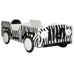 Bedtime will become a true adventure (in a good way) with the Safari Toddler Bed. Hand-crafted with imported laminated Baltic Birch this bed has been carefully constructed to make it easy to get into but hard to fall out of. This zebra-striped bed resembling a Jeep can accommodate any standard-sized crib mattress and is suitable for children 12 months to about 3 years or up to 50 pounds. Dimensions: 55L x 30W x 18H inches.About Just Kids StuffJus