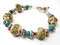 Lampwork bracelet with turquoise crystal and by thepinkmartini, $55.00