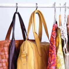 Use shower curtain hooks to hang heavier items and purses. Smart!
