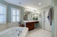 Traditional Master Bathroom with Raceway 8 Light Bath Bar by Sunset Lighting, Graber Blinds Custom Shutters., Custom Mirrors