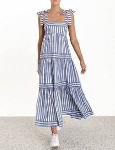 The Verity Stripe Tiered Tie Dress in Blue Stripe from our Summer Swim 2019 Collection. A striped maxi dress featuring a full A-line skirt for volume and movement with fixed tie shoulder straps. cotton, maxi dress with full a-line skirt, fitted at bust, Striped Maxi Dresses, Cotton Dresses, Casual Dresses, Fashion Dresses, Sleeveless Dresses, Tutu Dresses, Linen Dresses, Emo Fashion, Simple Dresses