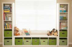 "You don't need to pay lots of money for a custom install — pay a visit to IKEA and grab three of their Kallax shelf units. Put one below the window and the other two standing on both sides of the window. Add storage boxes that fit into the shelves and a cushion on the ""bench"" and ta-da, you've got a great storage solution that looks great AND extra seating for your kiddos."