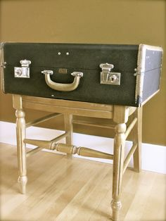 Vintage Suitcase turns side table. Sawed off the back of the chair and screwed the suitcase to the base. Total cost 2.50!