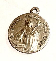 Vintage Saint Wivine French Holy Medal Charm (Image1)Rare Vintage religious medal featuring St. Wivine Priez Pour Nous (pray for us). Marked FRANCE on the front Perfect for a charm bracelet or Christening, Baptism, Communion, Conformation or newborn baby gift
