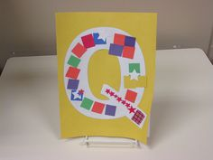 """A """"Q"""" for quilt made from a """"Q"""" and square pieces of paper"""