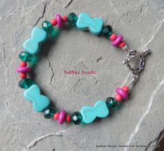 Turquoise and howlite bracelet with crystal.  www.facebook.com/bubbasbeads