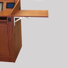 MLP-35 Prairie Style Lectern with New Harvest Oak Finish - Raised Position. This lectern has an electrical, height adjustable, side drop leaf. #Prairie #Lectern #Custom #Infocomm2012