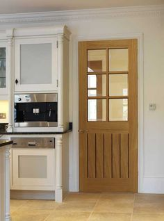 Oak Cottage - Tutbury - Stylish oak glazed door with individually boarded  bottom panel. Matching