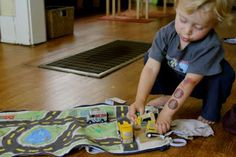 What a great idea! DIY Matchbox Car Mat Backpack! (backpack unzips to lay flat)