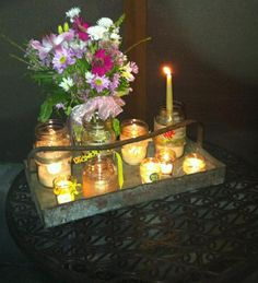 candles- with Christmas flowers or bulbs