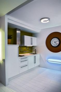 The Modern Apartment Painted Using White Color and Colorfull Sofa: combine white and green kitchen set in the kitchen room set