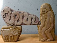 3 pieces of Myth and Future Myths (Endanger species) clay sculptures by Kathleen Scott stacked