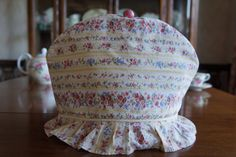 Shabby Chic Yellow Striped Floral Print Insulating Fabric Tea Cosy / Cozy with Piping, Frilly Trim and Custom Polymer Clay Bead Pull Top $45.00 CAD